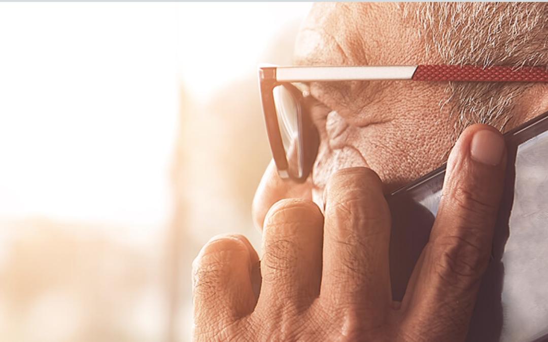 retired man on smart phone